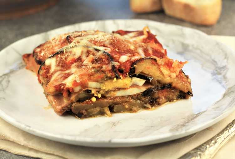 slice of mom's eggplant parmigiana on white plate