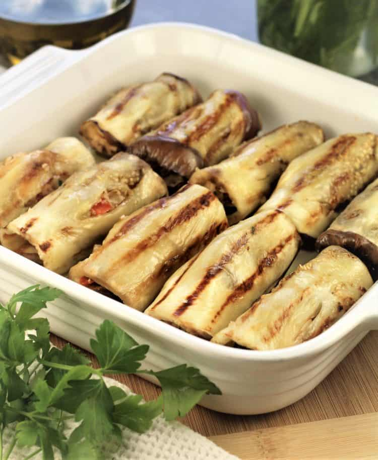 white baking casserole filled with Grilled Eggplant Involtini
