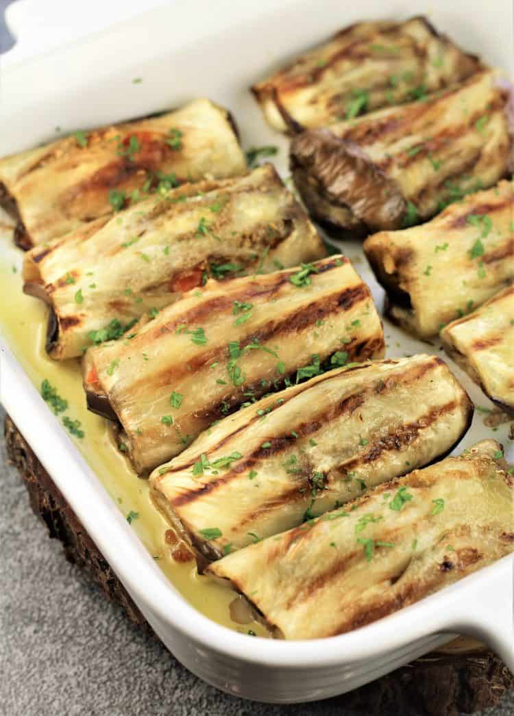 white baking dish filled with Grilled Eggplant Involtini