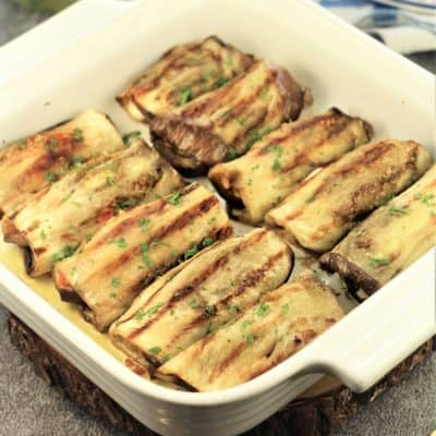 grilled eggplant involtini in a square baking dish
