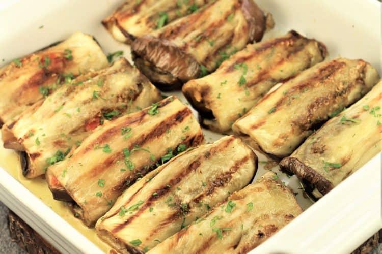 grilled eggplant involtini in a square baking dish