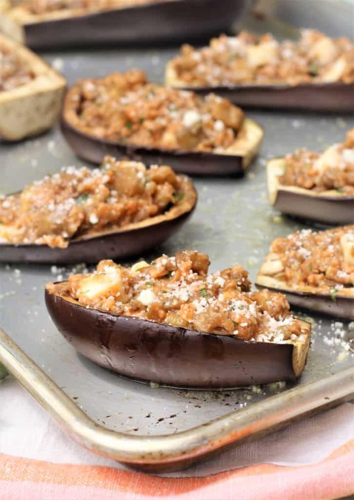 stuffed eggplant halves on baking sheet