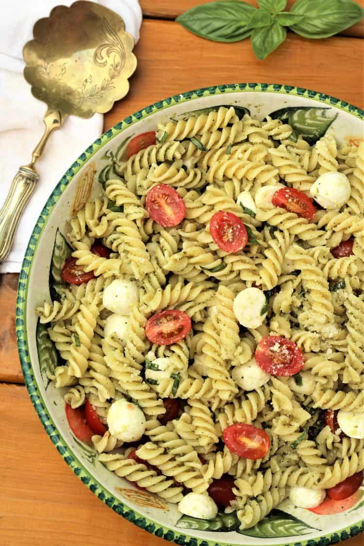 large bowl filled with Caprese pasta salad with pesto
