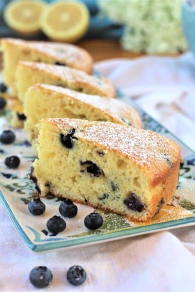 slices of blueberry olive oil cake on rectangular plate
