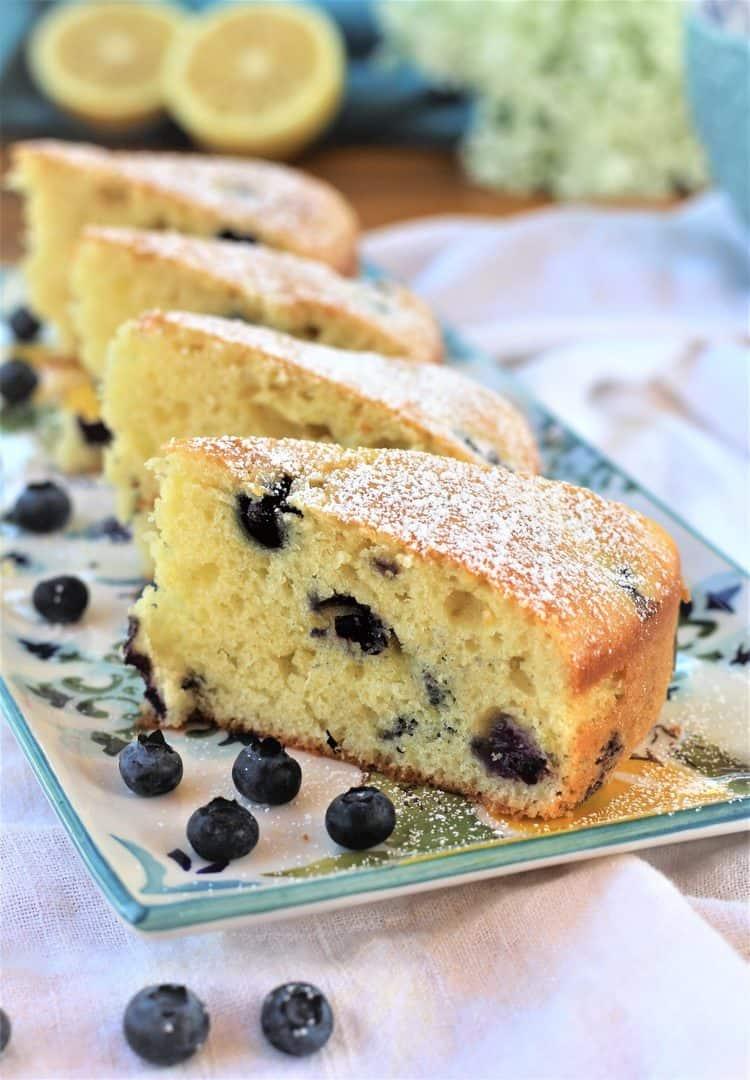 slices of blueberry olive oil cake on rectangular plate