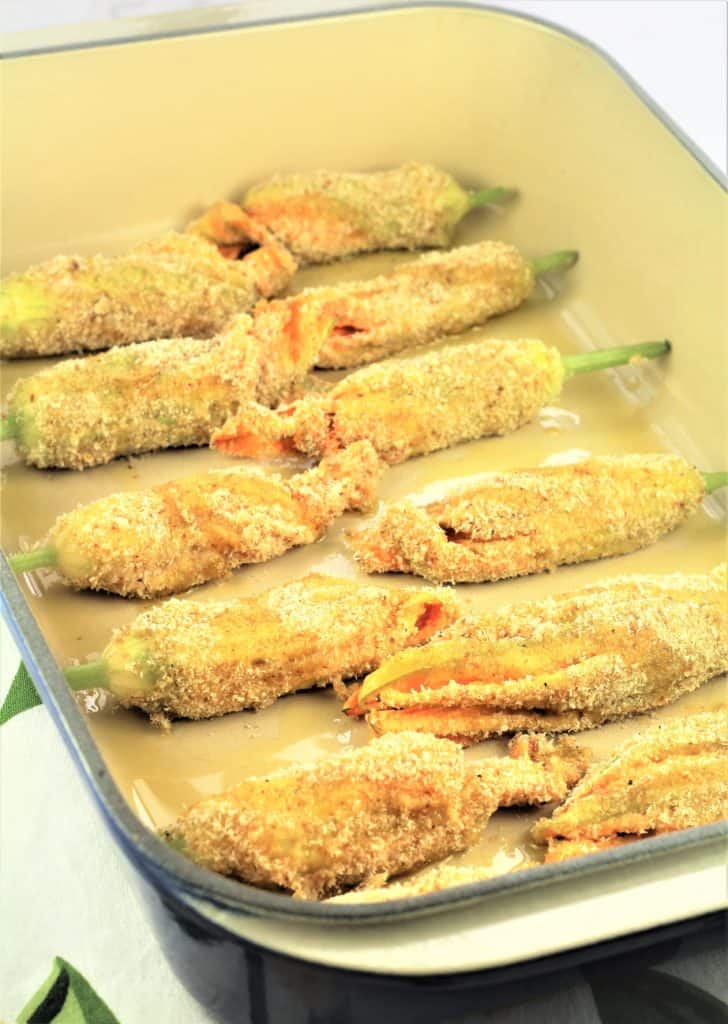 breaded zucchini flowers in casserole dish