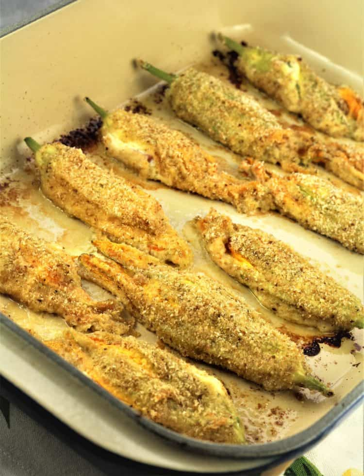 baked stuffed zucchini blossoms on baking dish