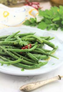 italian green bean salad in white plate