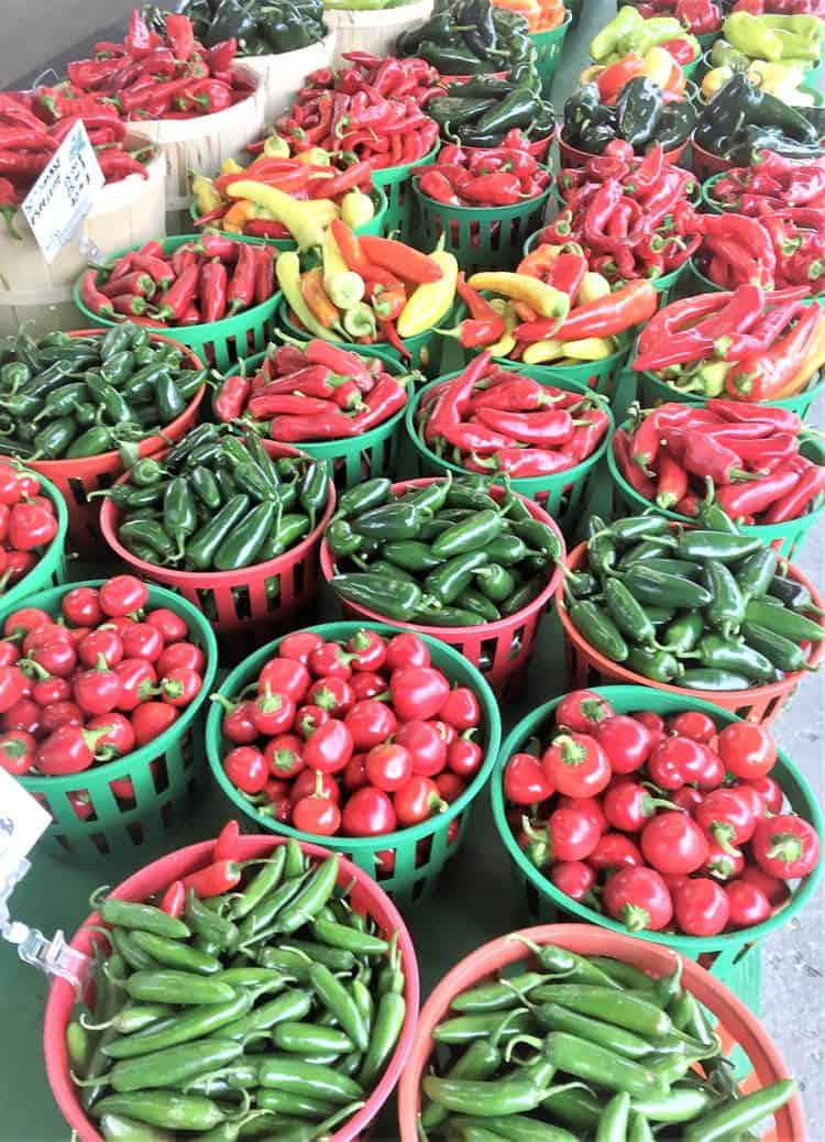bushels of colorful peppers at the market