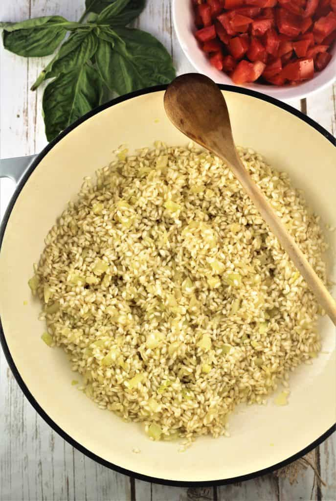 pan with sautéd onion and arborio rice