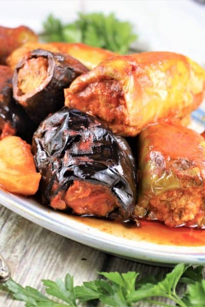 stuffed peppers and eggplant with tomato sauce piled on a platter