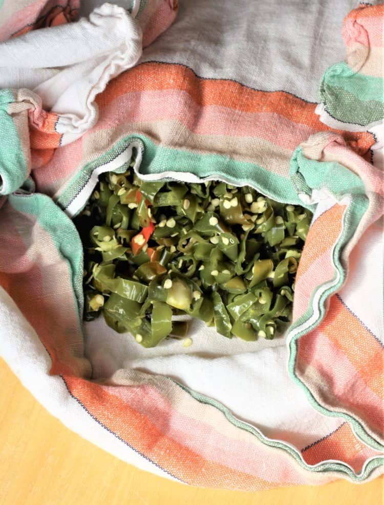 hot green pepper rounds in dish cloth