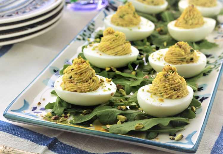 arugula covered rectangular platter of deviled eggs