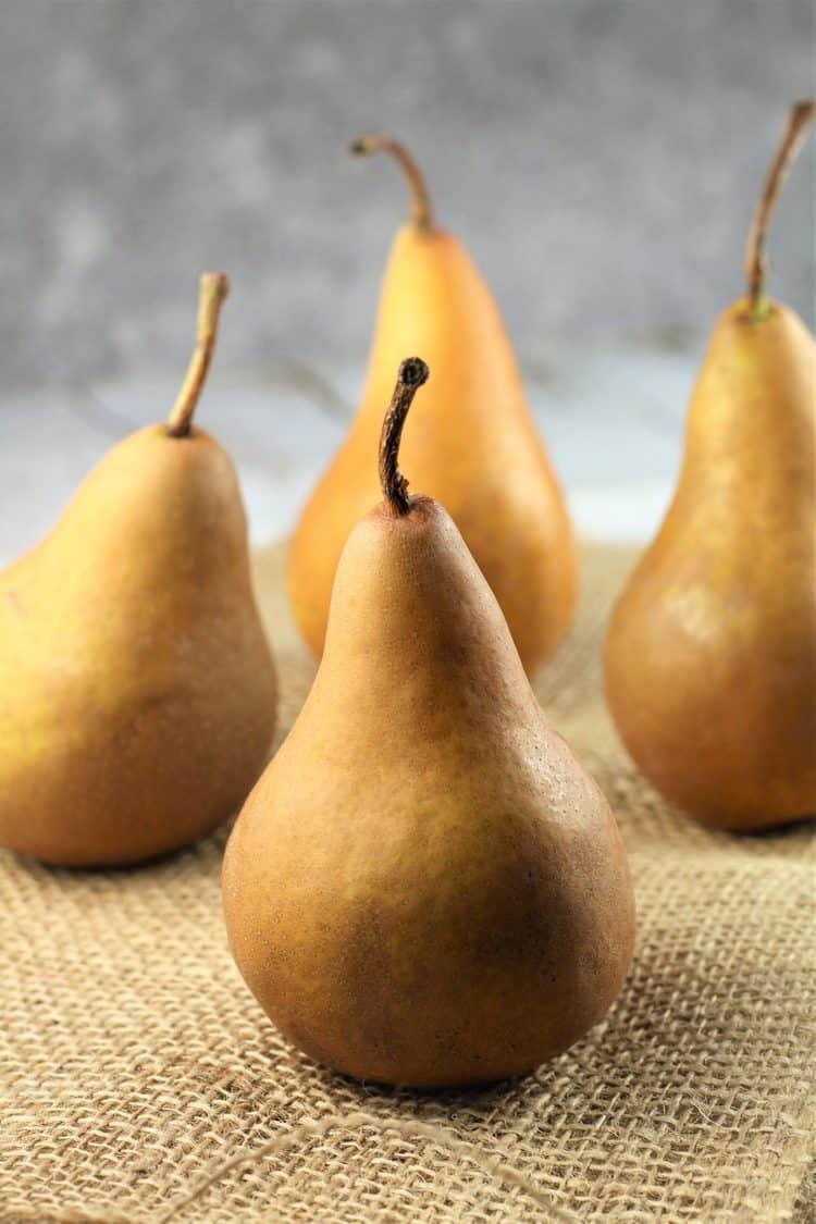 4 Bosc pears on burlap