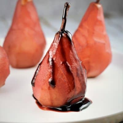 red wine poached pear drizzled with syrup