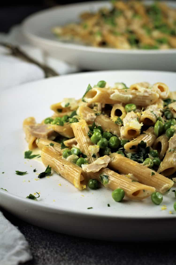 Pasta with Tuna and Peas in a Cream Sauce in white plate