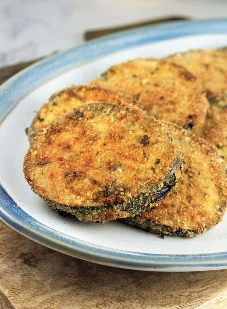 white blue rimmed plate with Crispy Baked Eggplant Cutlets