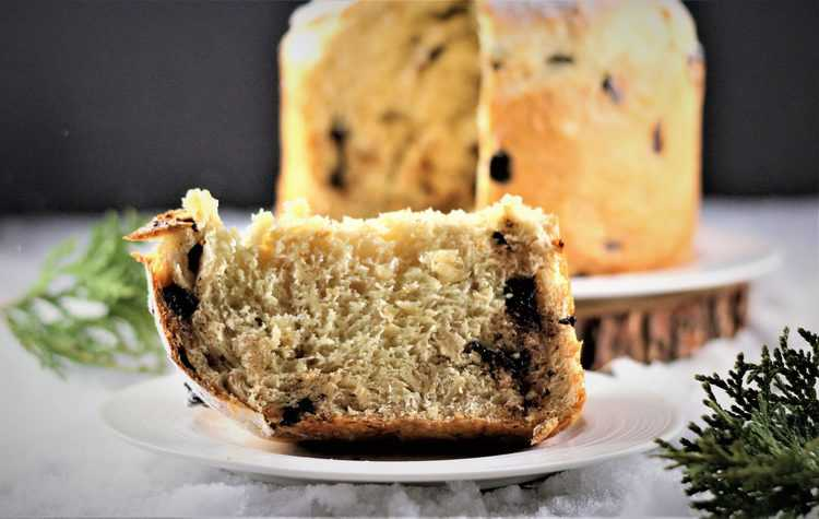 wedge of dark chocolate and almond panettone on plate