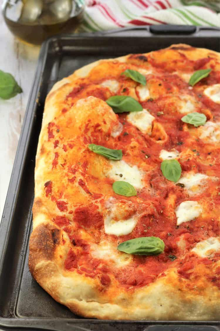 no knead pizza Margherita on baking sheet