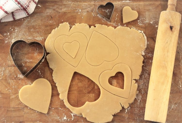 cutting heart shapes out of cookie dough