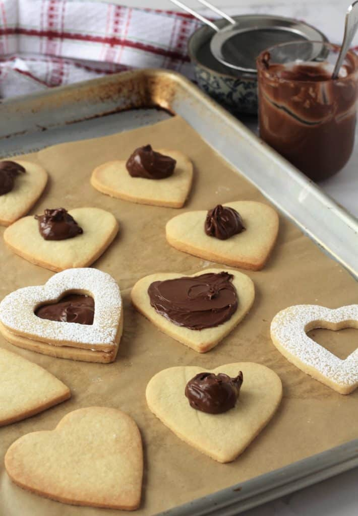 spreading Nutella on heart shaped cookies