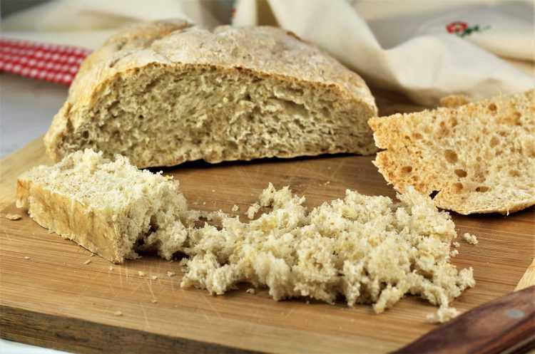 loaf of Italian bread torn into breadcrumbs