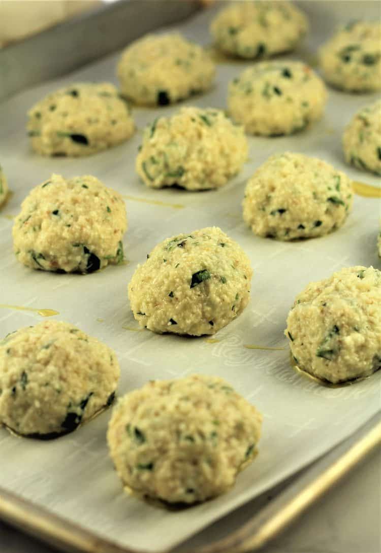 individual rolled meatless meatballs on baking sheet covered in parchment