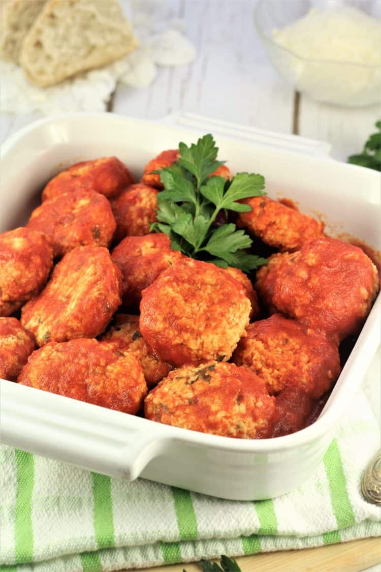 white square dish filled with meatless meatballs with parsley sprig