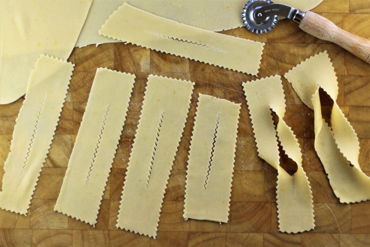 strips of dough shaped into chiacchiere