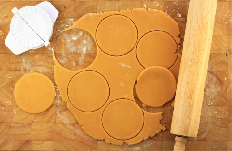 empanada cutter cutting circular dough pieces