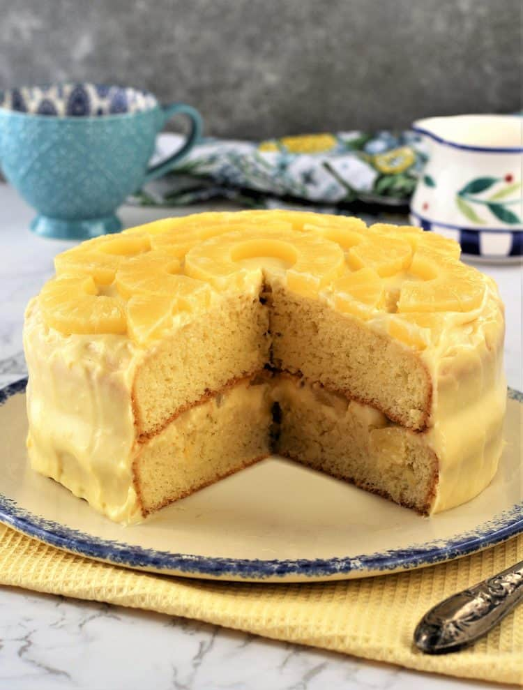 pineapple layer cake with pastry cream cut open to reveal inside layers