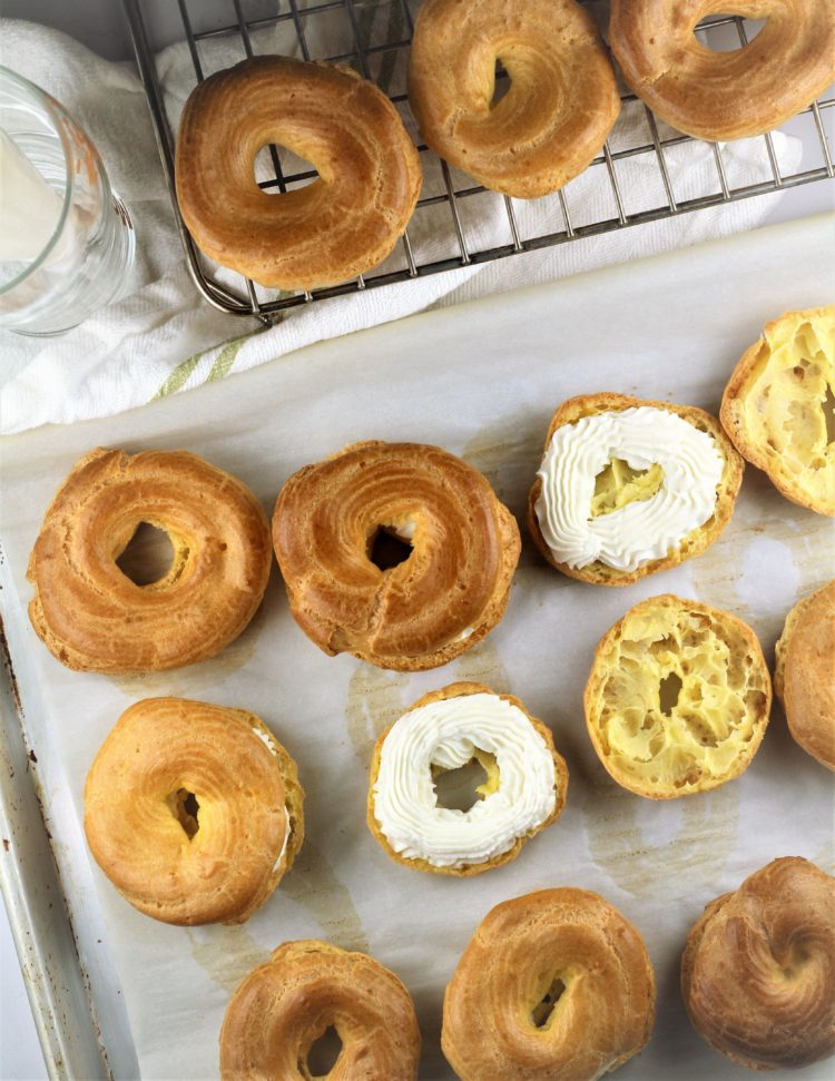 filled choux pastry with ricotta cream on baking sheet