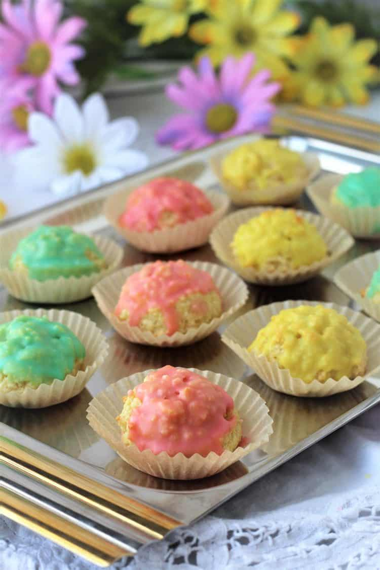 tray of colorful iced almond paste cookies