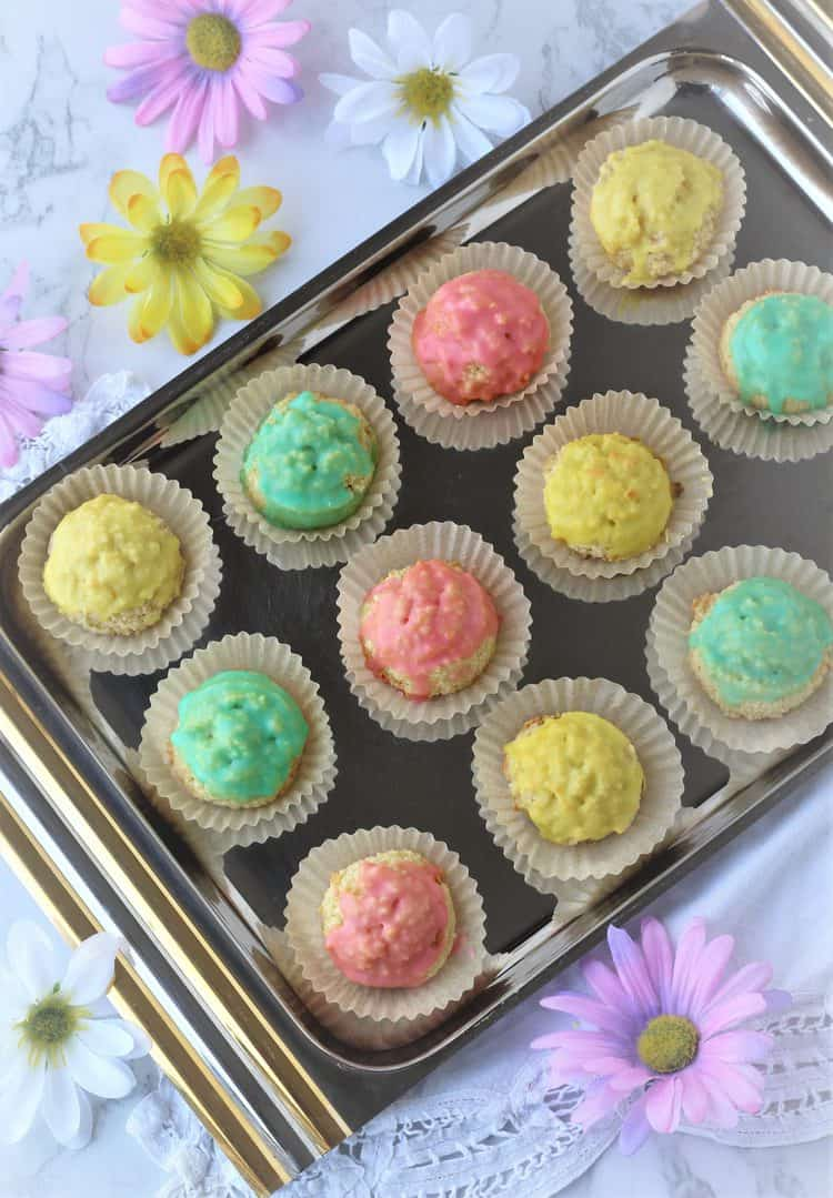 silver tray with colorful iced almond paste cookies