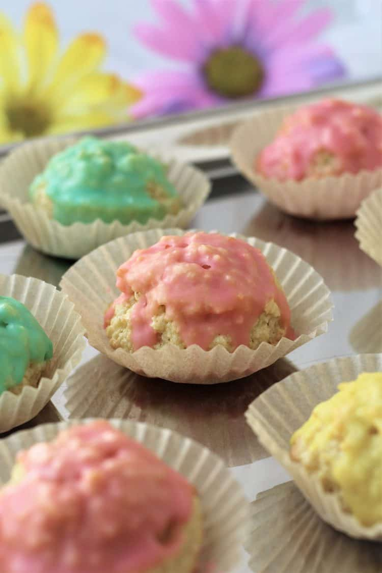 colorful almond iced cookies on silver tray