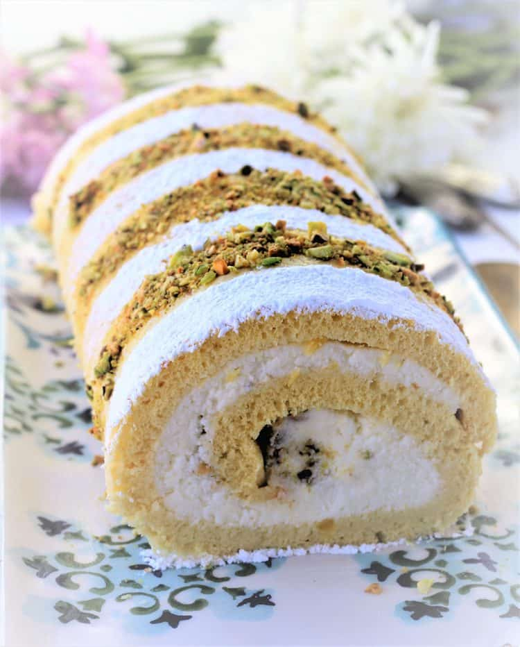 ricotta and pistachio roll cake on serving platter