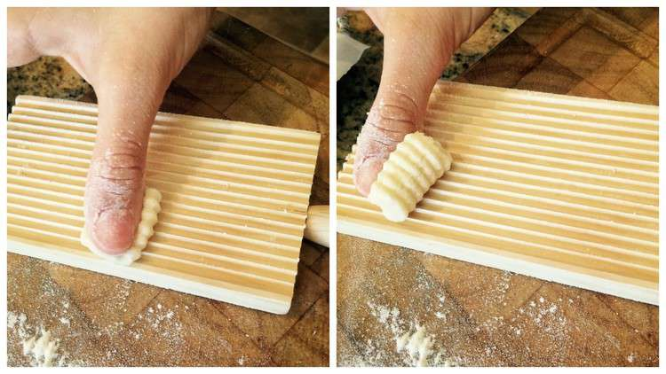 rolling gnocchi with thumb on wood gnocchi board