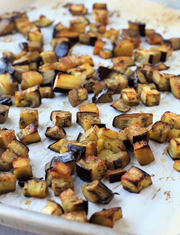 roasted eggplant cubes on baking sheet