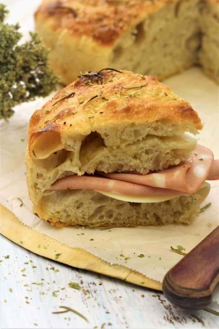 herbed focaccia cut in half and stuffed with mortadella and cheese