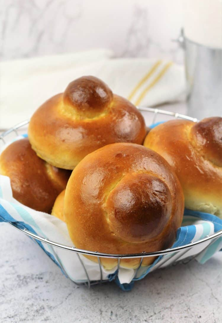 basket filled with Brioche with a bun on top