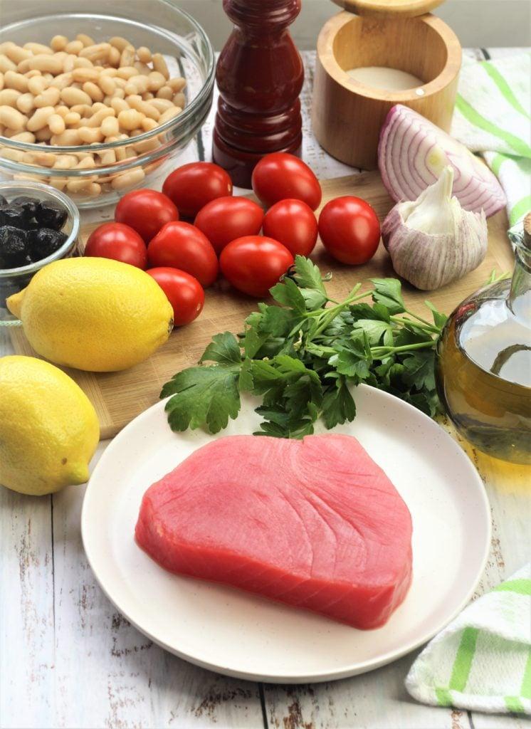 raw tuna steak, lemons, cherry tomatoes, parsley, garlic, onion, white beans, salt and pepper
