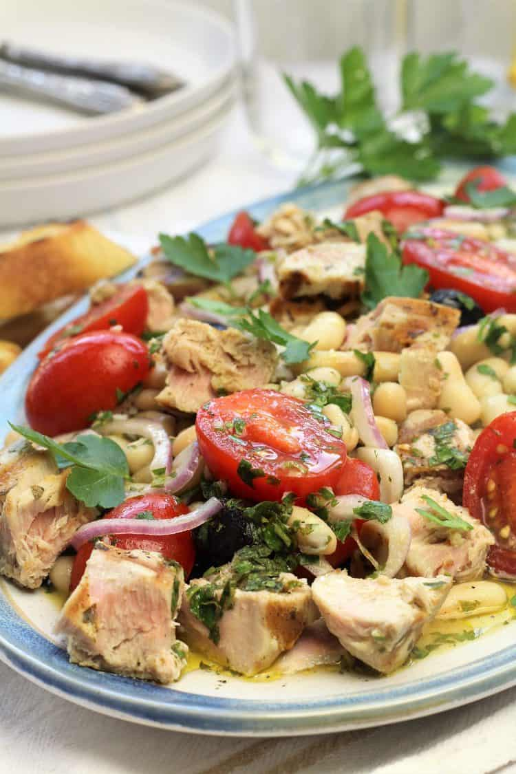 closeup of tuna and white bean salad on oval platter