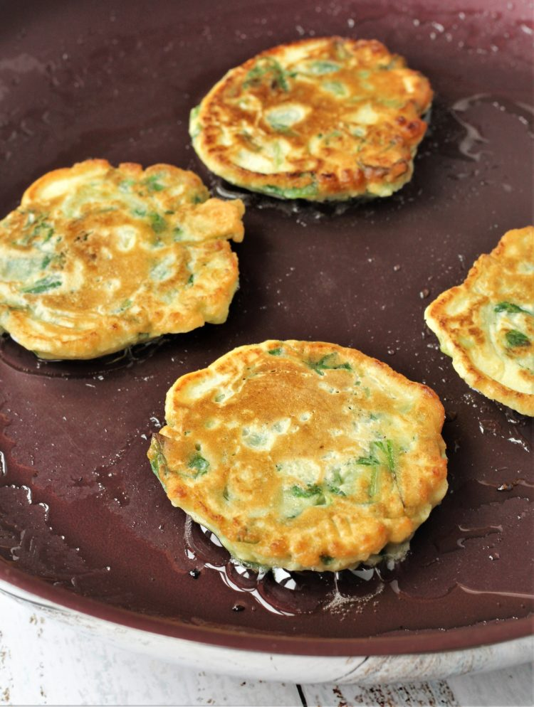 browned swiss chard fritters in skillet