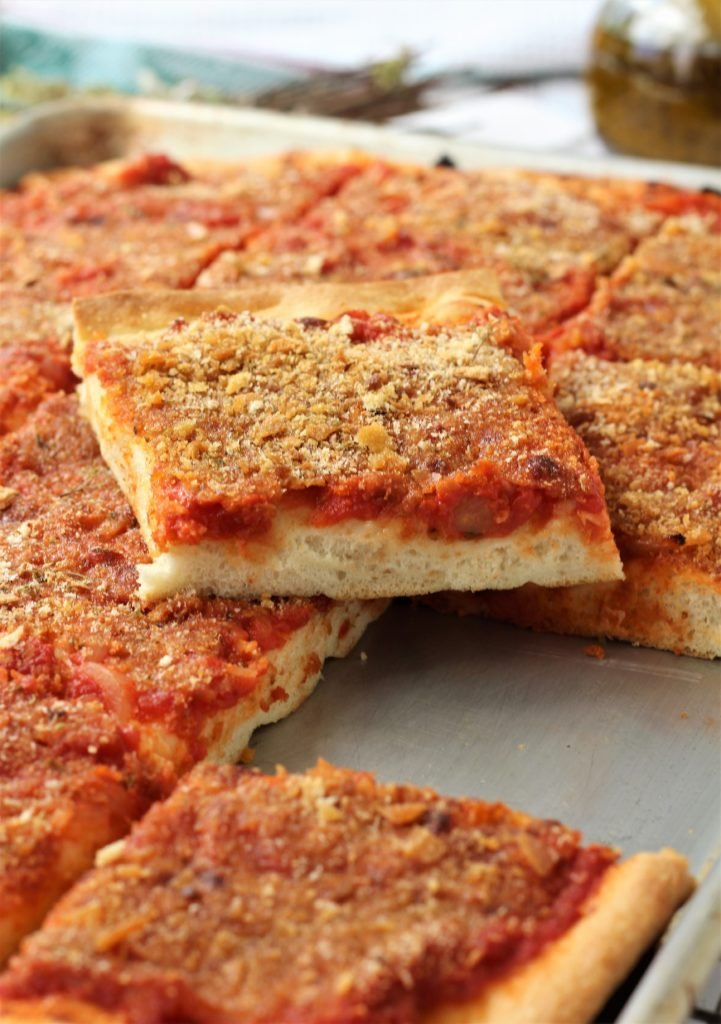 sheet pan filled with squares of sfincione pizza