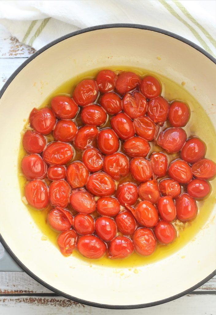 blistered cherry tomatoes in oil in large skillet