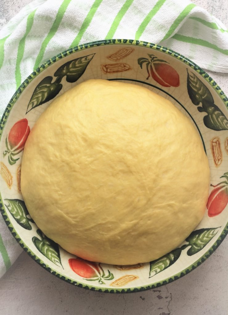 proofed bomboloni dough in bowl