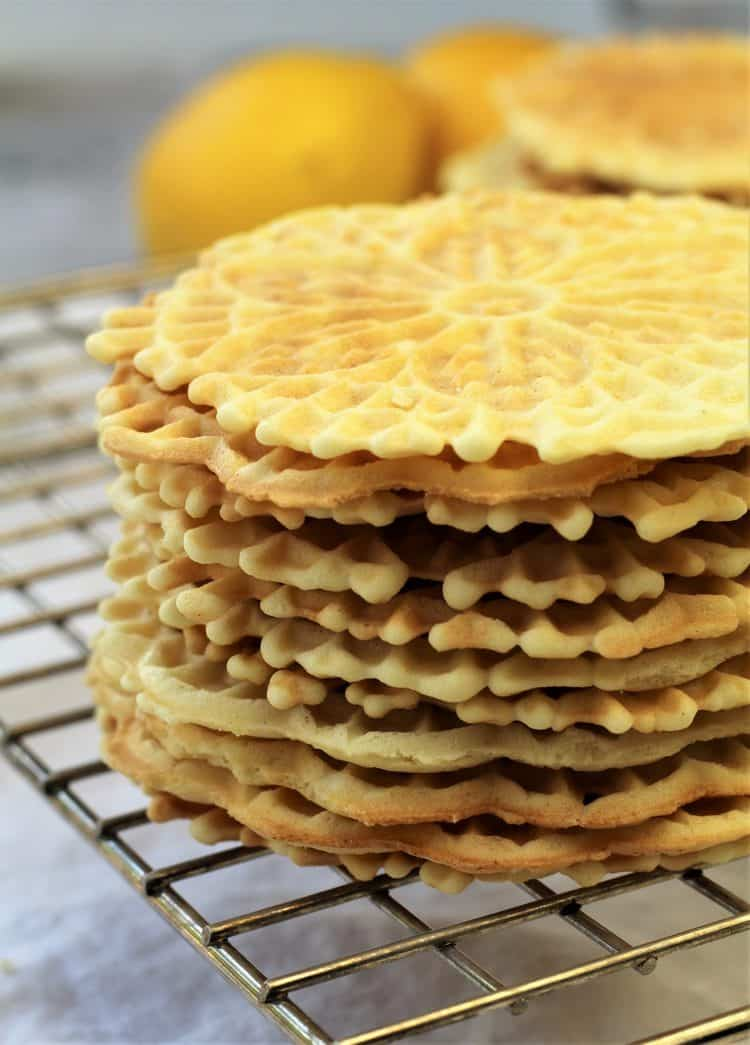 stacked pizzelle cookies on wire rack