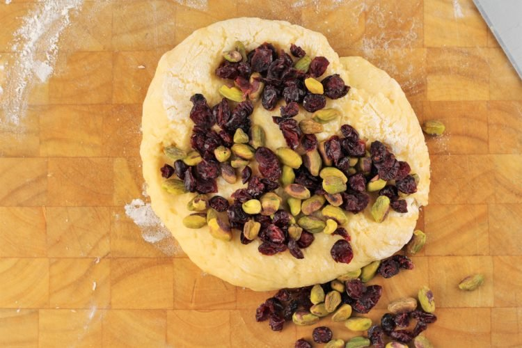 pistachios and dry cranberries on circle of biscotti dough
