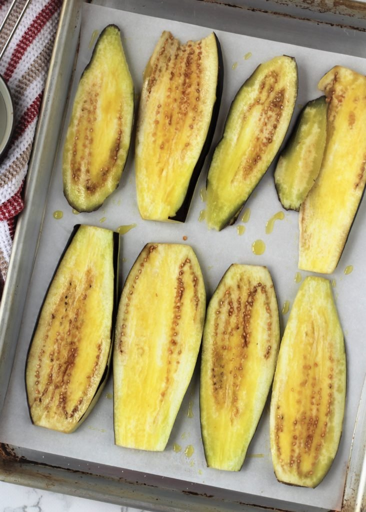 eggplant slices brushed with oil on baking sheet