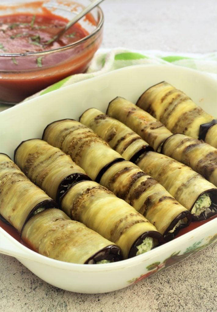 eggplant involtini arranged in baking dish